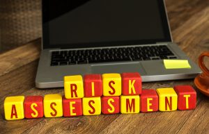 Risk,Assessment,Written,On,A,Wooden,Cube,In,A,Office